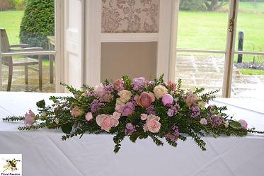 pastel ceremony table arrangment.jpg
