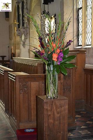 orange and purple vase on plinth.jpg