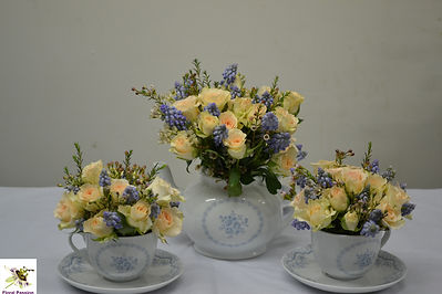 teapot and teacups muscari and spray ros