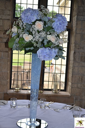 tall champagne flute vase with blue hydr