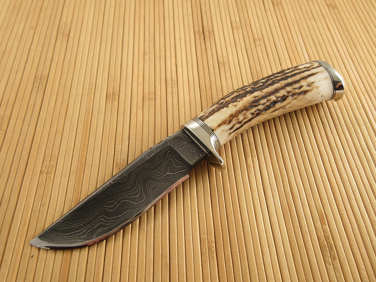 Stag and Damascus Hunter