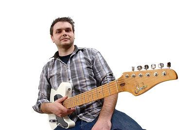 Guitar teacher in a checkered shirt holding an electric guitar