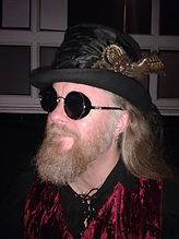 A man with steampunk hat and glasses