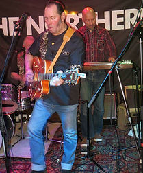 Rockabilly guitarist playing live
