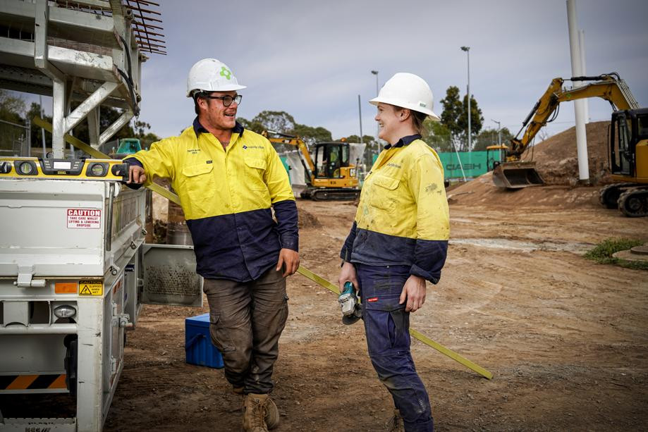 manager and apprentice on work site