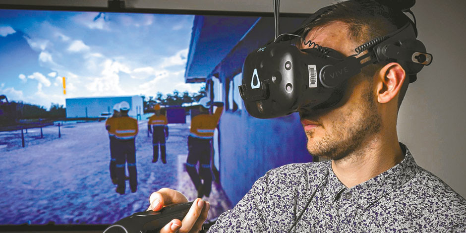 NEW ANGLE: SA Power Networks Virtual Reality specialist Joshua Keightley uses VR goggles to demonstrate a 3D training environment reflecting a real-life electrical substation. Picture: Mike Burton, Newscorp.