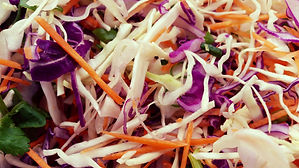 freshly sliced coleslaw including carrots and cabbage for pulled pork rolls