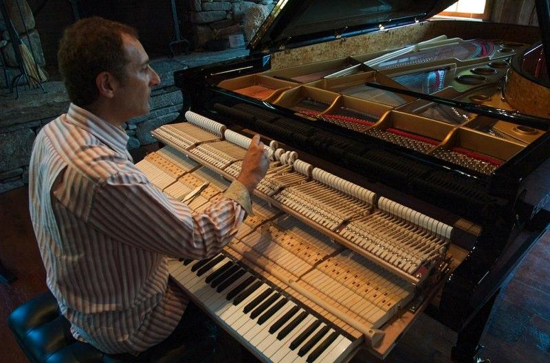 Arlan working on a Fazioli piano