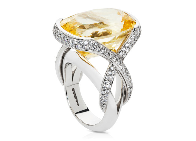 28ct cusshion cut natural yellow sapphire ring with 1.10ct pave set diamonds