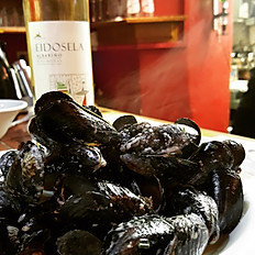 Local Mussels cooked in a cream, garlic and herb sauce