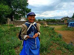 בת למיעוט הנאשי, באיישה, העיר העתיקה של ליג'יאנג, מחוז יונאן