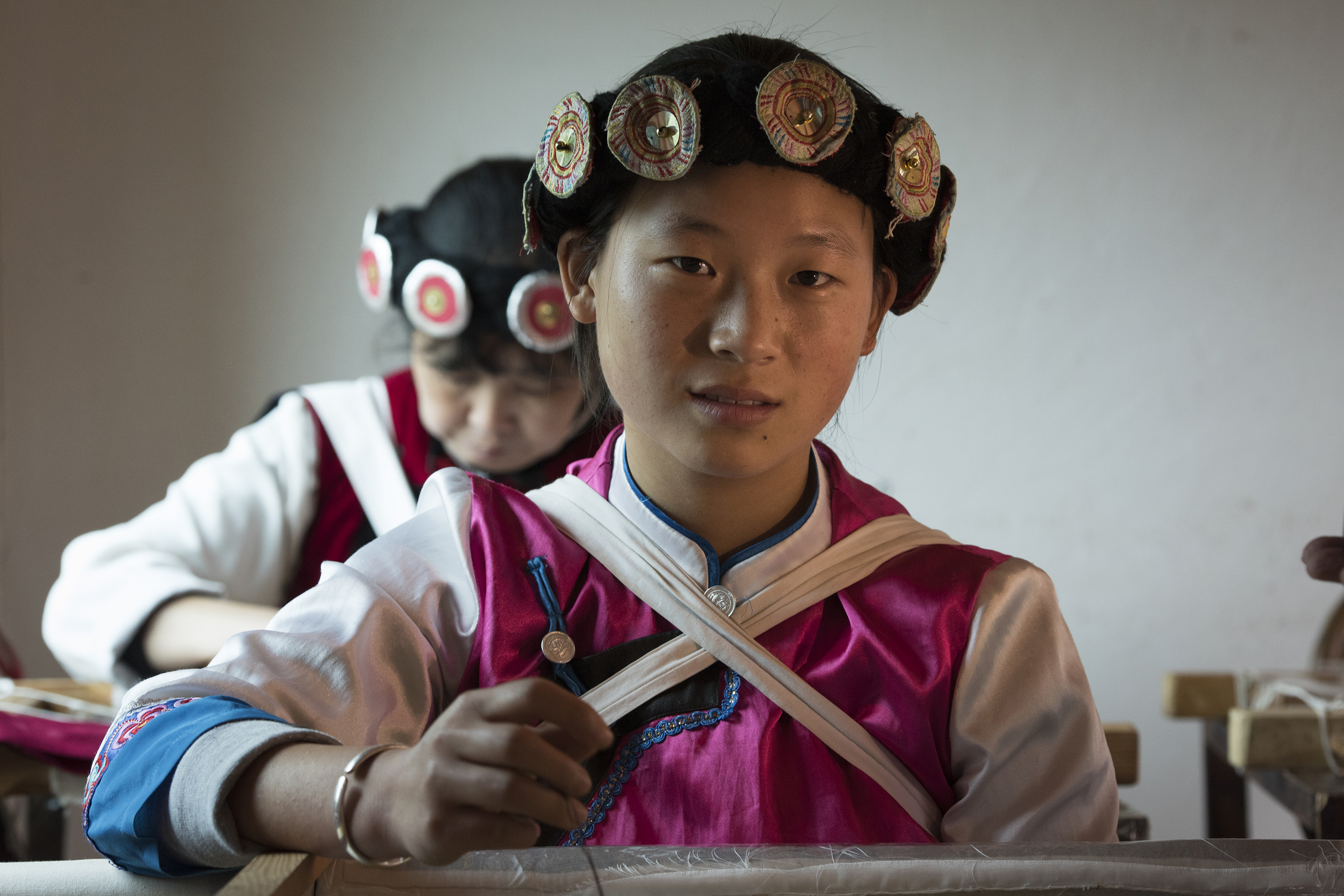 בנות נאשי רוקמות, ליג'יאנג, יונאן