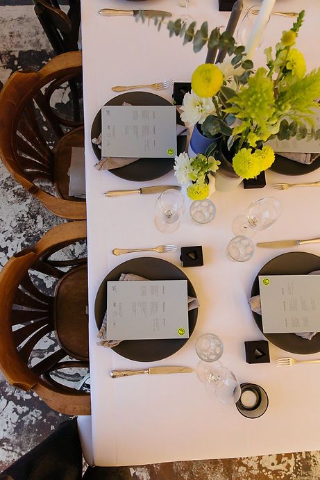 taube grau tablesetting event design plate flowers chairs studio cherie