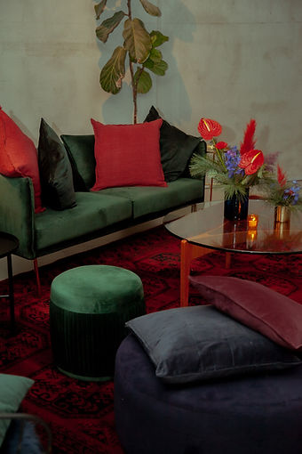 couch red green set design event design pillows candles atelier