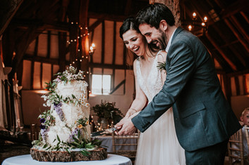 Bride and Groom cutting wedding cake, EPS Photography, Smeetham Hall Barn, Suffolk Wedding Photographer