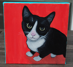 black cat painting red.png