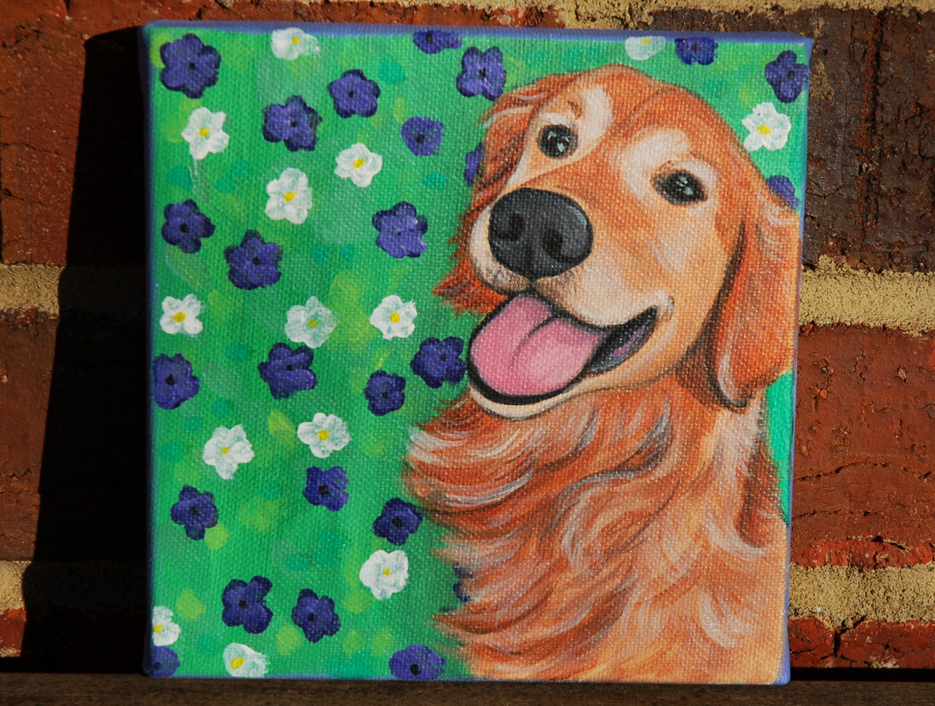 happy golden retriever painting flowers.png