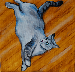 fat cat painting laying on floor