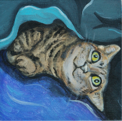 sleepy cat painting in bed