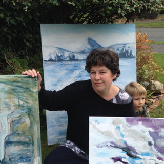 Artist and her son and artworks