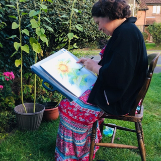 Painting a sunflower by Kirsteen Lyons Benson