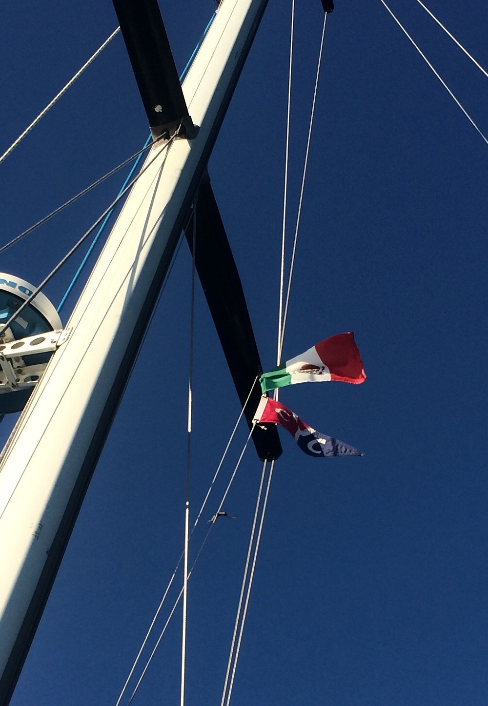Flying our CYC burgee and Mexico courtesy flag.