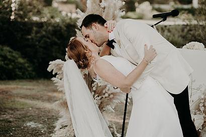 bride groom kiss ceremony tuxedo veil love & provence