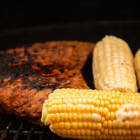 Tri-tip steak with corn on the cob.