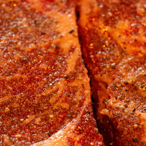 Raw ribeye steaks.