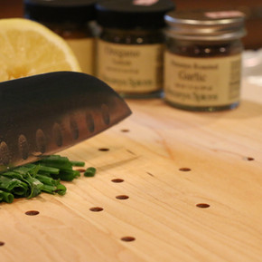 Sharp knife cutting chives on the best cutting board.