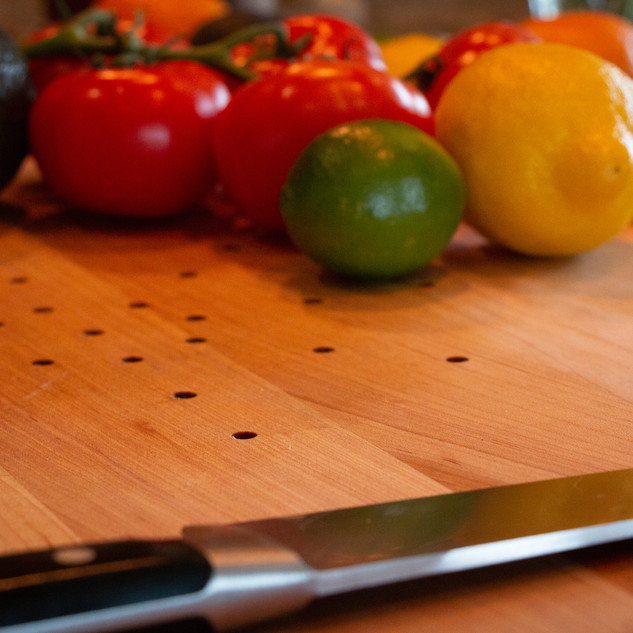 The Juice Catching Cutting Board, as seen on YouTube.
