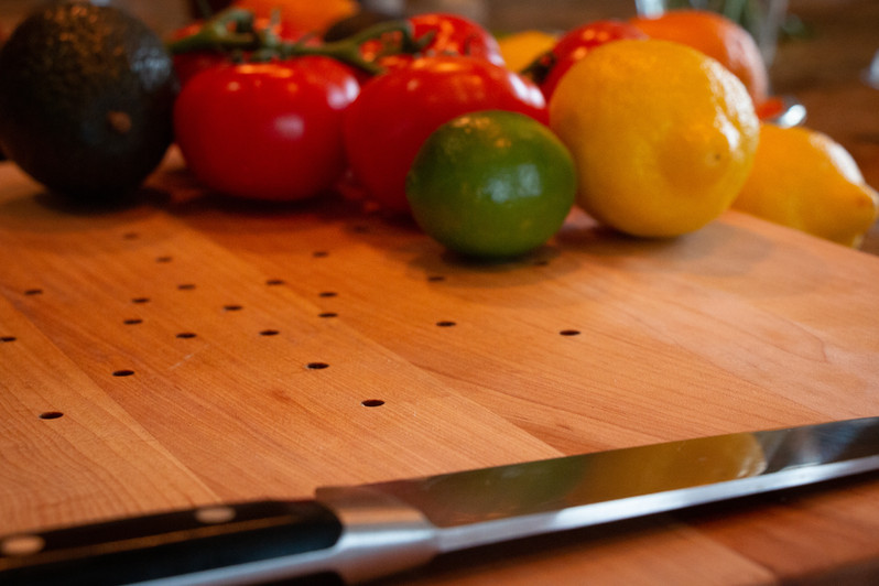 Juice Catching Cutting Board with knife and salsa ingredients