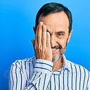 middle-age-hispanic-man-wearing-casual-clothes-covering-one-eye-hand-confident-smile-face-