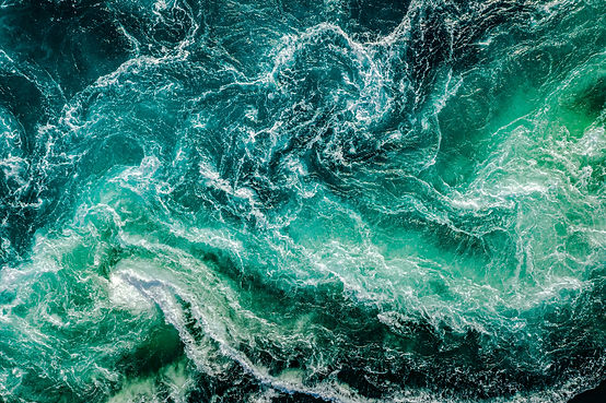 Waves of water of the river and the sea meet each other during high tide and low tide. Whi