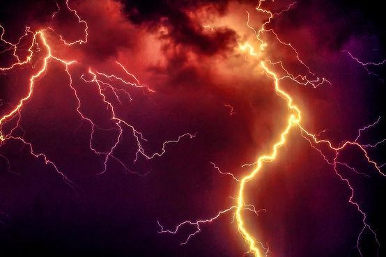 orange thunderstorm night sky.jpg