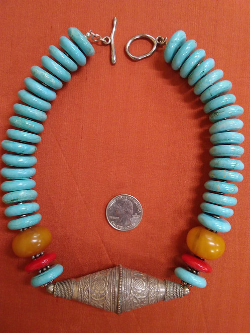 Turquoise necklace with silver botanical focal