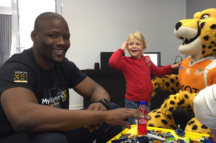 rugby Springbok Oupa Mohoje at Reach for a Dream in his specially branded MyPlayers bonhappi-T