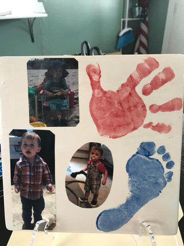 Darling pictures Mod Podged onto a painted tile with hand and foot prints!