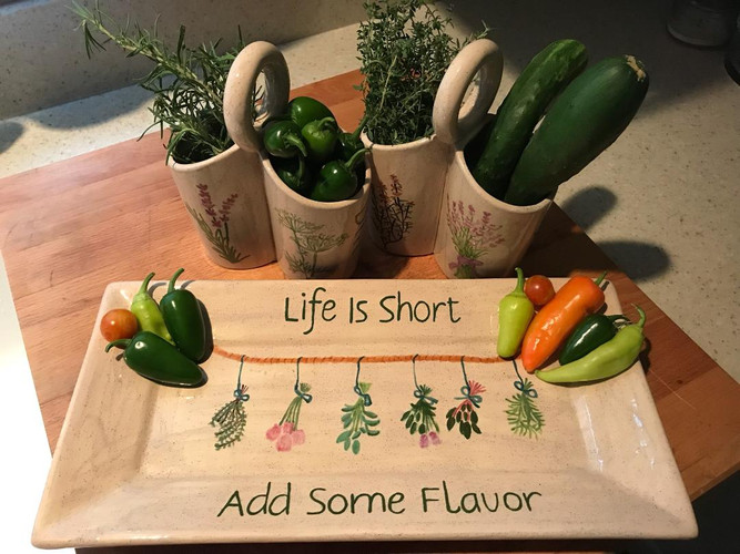 Paint caddies as herb and vegetable holders!