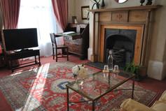 Antique writing bureau and fireplace
