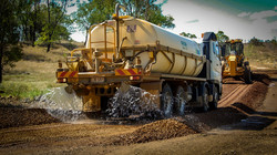 Water Application is Critical To Good Road Team