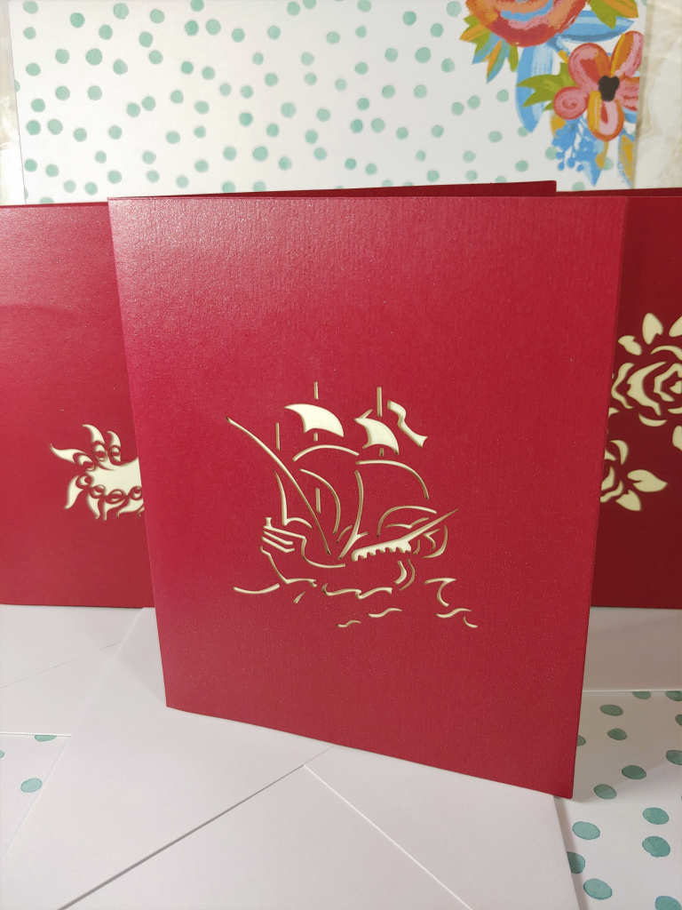 Meihejia 3D Pop up Greeting Cards front with pirate, peacock and bouquet cut-outs