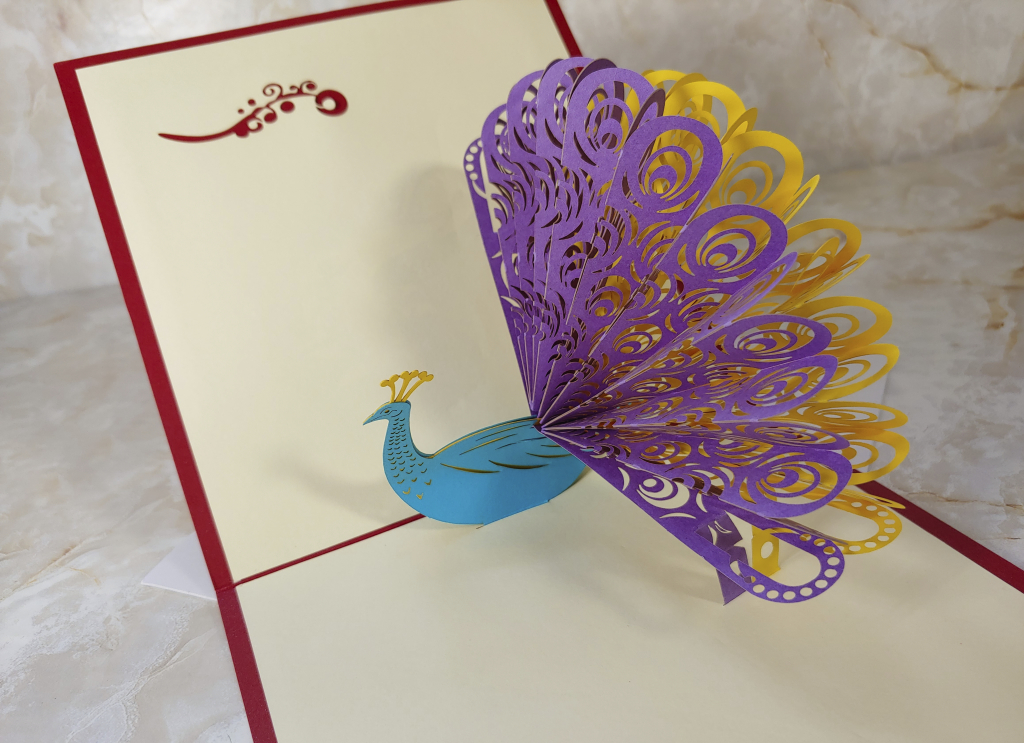 Pop up Greeting Card with a colourful peacock inside