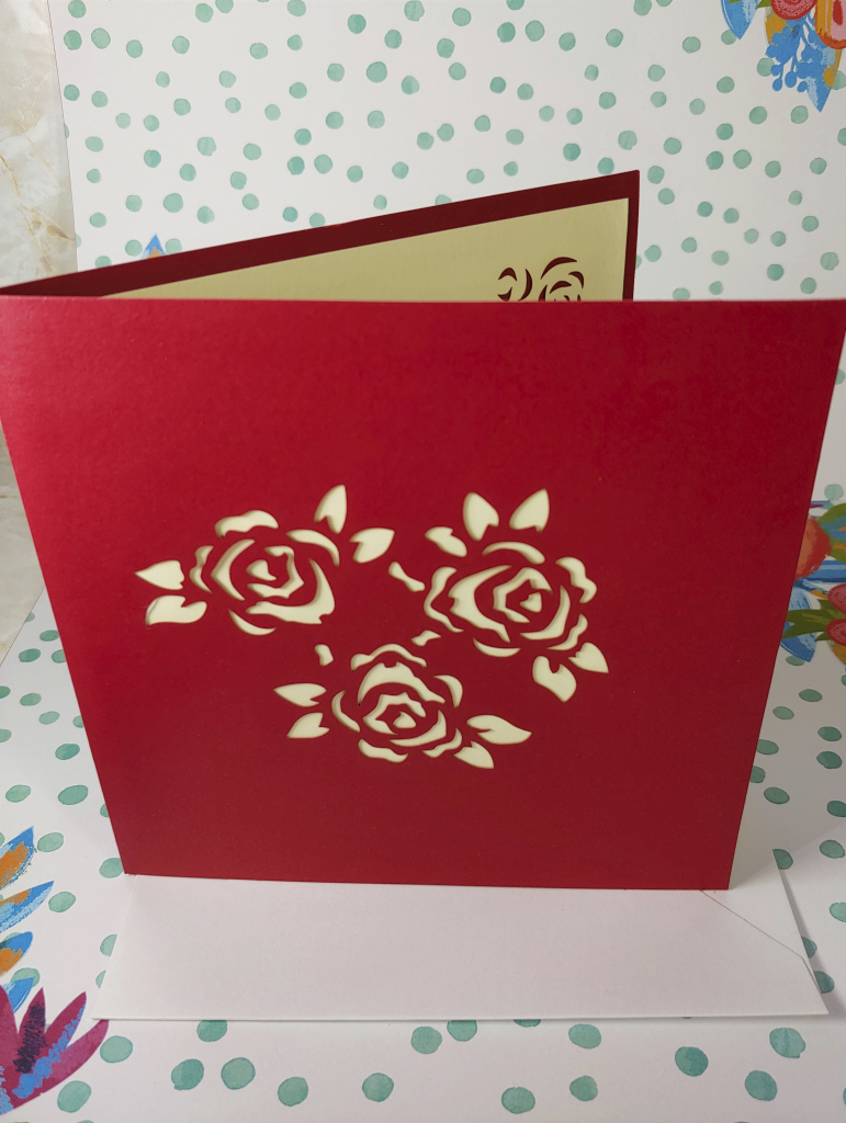 Meihejia 3D Pop up Greeting Card with a rose floral design cut out on front