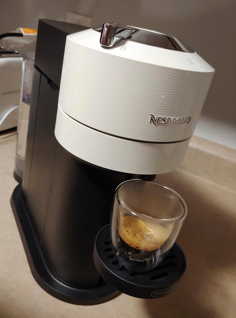 White and black Nespresso Vertuo Next Espresso Machine with Espresso cup