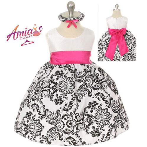 Black and white dress with pink waistband and sash in back
