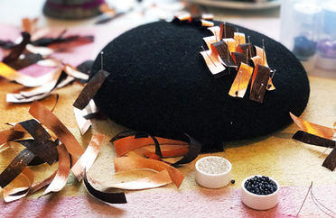 Decorating a hat with hand crafted foil fabric