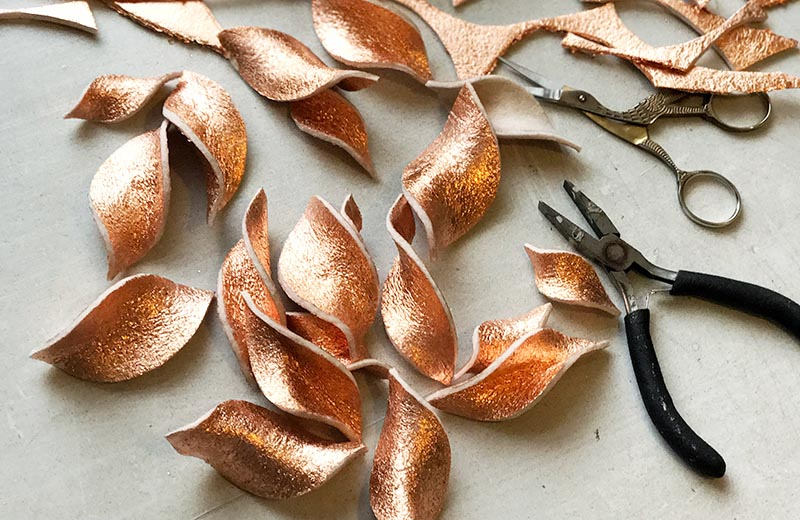 Felt leaves covered with copper color foil