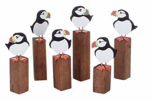 Puffins on post.