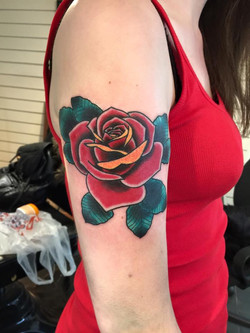 Cover-up rose tattoo